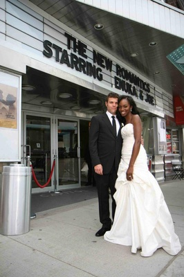 Actress Enuka Okuma and husband in front of theater marquee