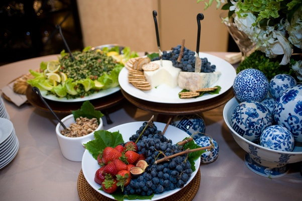 Wedding blueberry, fig and cheese table at cocktail hour