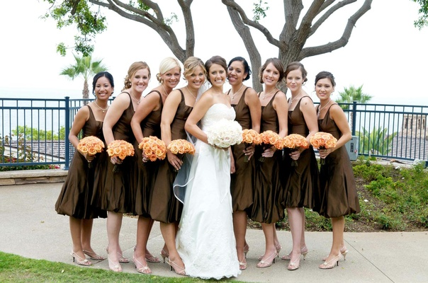 Brown bubble skirt dresses and orange bouquets