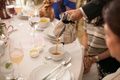 Server pouring tea into tea cup at bridal shower