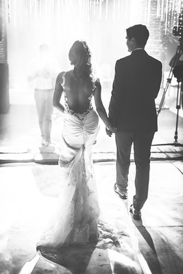 black and white photo of couple walking away wedding destination morocco marrakech galia lahav dress