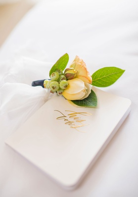 wedding boutonniere for groom yellow peach white green white gold foil his vows booklet