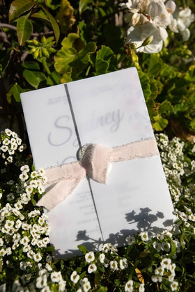 Echosmith singer Sydney Sierota and Cameron Quiseng wedding ceremony program frayed edge ribbon wrap