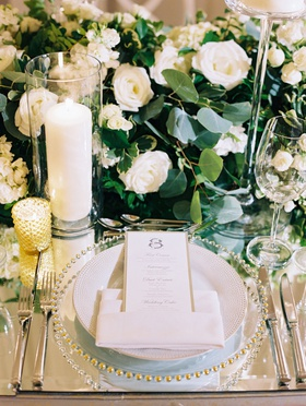 Wedding reception mirror table top with greenery and white flower runner candles gold candle votive
