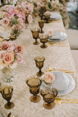 taupe embroidered table linen gold wine glasses silverware shades of pink roses low centerpieces