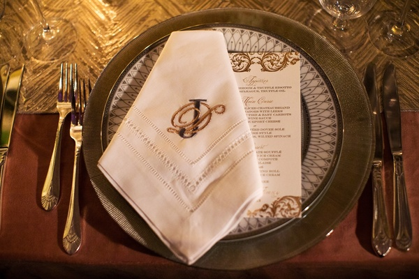 Silver and gold place setting and china plates