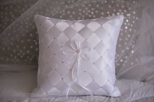 Satin checkered ring bearer pillow with rhinestone pearl details and thin ribbon for rings