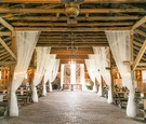 White drapery from wood rafters beams barn rustic wedding ideas locations venues