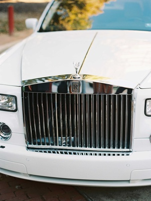 Close up shot of grill on Rolls Royce car white and silver