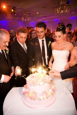 Two layer pink cake with sparklers on top
