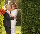Comedian comedic writer Carol Leifer and her wife Lori Wolf on wedding day orange calla lily bouquet