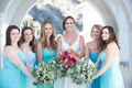 bride and bridesmaids smile blue dresses pink flowers green bouquets