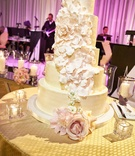 five-tier buttercream wedding cake with cascading petals