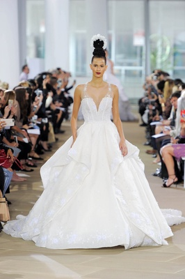 Floral embellished sleeveless illusion sweetheart ball gown with inverted apron skirt, illusion back