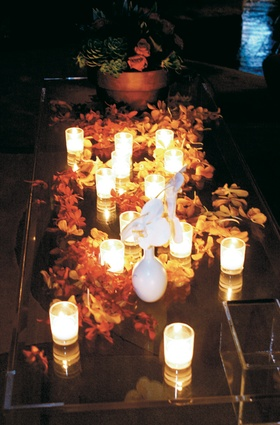 Tropical flowers covering candlelit table