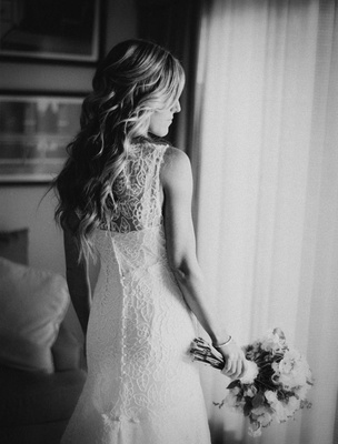 Black and white photo of a bride in a Monique Lhuillier sleeveless lace gown