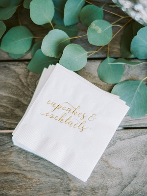 """engagement party inspiration, white cocktail napkins with gold emboss """"cupcakes & cocktails"""""""