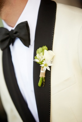 White rosebud and greenery wrapped in burlap