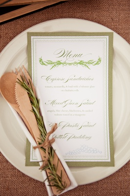 Menu on plate with silverware and rosemary