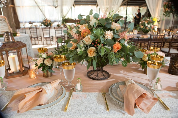 Gold rim glassware blush pink napkin lace gold flatware rustic wedding lantern centerpiece ideas