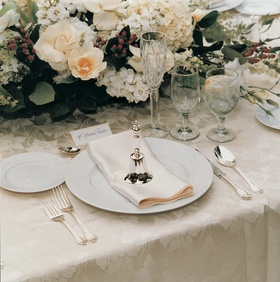 Off-white place setting and flowers