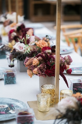 small vases with burgundy, peach roses, astilbe, mercury votives