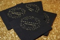 black paper napkins with gold writing a countdown and the couples new last name NYE wedding
