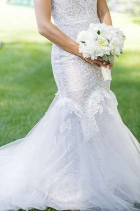 bride in custom hayley paige wedding dress with bridal bouquet of white peonies