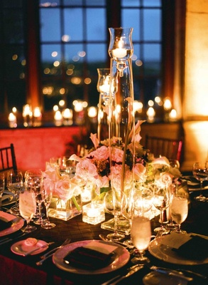 Tall floating candles and short floral arrangement