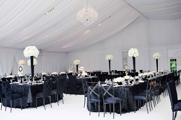 Black and white modern wedding with unique details in cincinnati white tent with flower centerpieces and black linens and chairs junglespirit Images