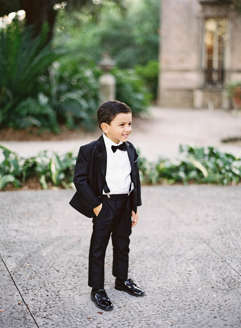 Ring bearer in patent leather shoes, suspenders, tuxedo, bow tie miami wedding
