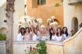 Bride and bridesmaids show off their white bouquets