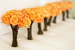 Long-stemmed, orange rose bridesmaids bouquet