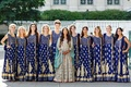 pakistani bride and her bridesmaids dressed in blue and gold traditional gowns pose
