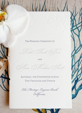 White and grey booklet with embossed motif