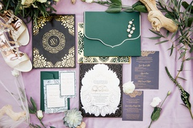 wedding invitation suite oda creative green envelope purple envelope gold laser cut details