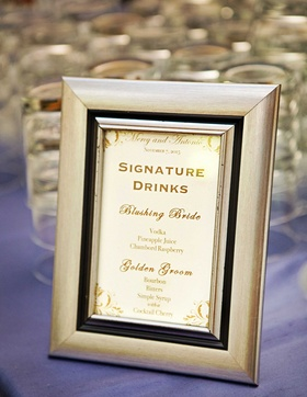 Framed signature drink menu with Blushing Bride and Golden Groom special cocktails