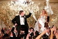 Groom in a black tuxedo & bride in a strapless Pnina Tornai dress hora dance