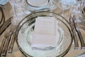 Silver-rimmed plate with white menu card