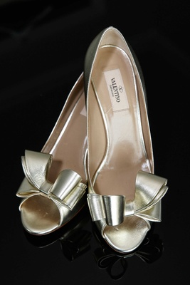 Gold shimmer metallic wedding shoes by Valentino with bow details at toe