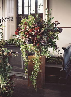 wedding ceremony judicial chamber rhode island greenery cascading down burgundy flowers large window