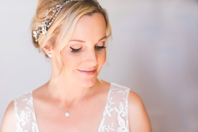 Bride in natural look makeup, sparkling headband, Tiffany & Co. diamond earrings, necklace