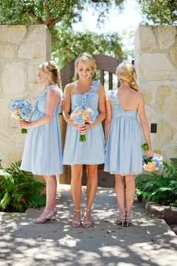 Blonde bridesmaids in short asymmetrical gowns