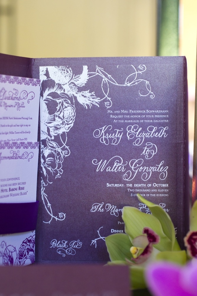 White calligraphy on folding purple wedding invite
