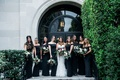 Bride in white dress sweetheart neckline with bridesmaids in black off shoulder bouquets burgundy