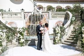 Wedding photos first look bride in flower marchesa gown mark ingram atelier groom in tom ford