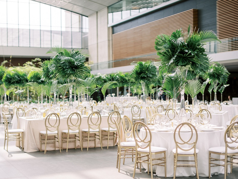 cleveland museum of art wedding reception tropical greenery heatherlily gold chairs modern look
