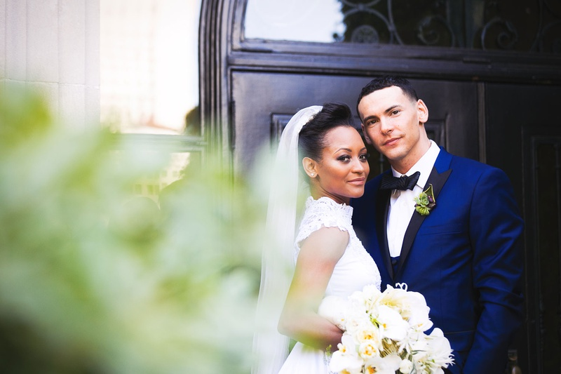 African American couple wedding at vibiana blue tuxedo black lapel high neck lace bridal gown