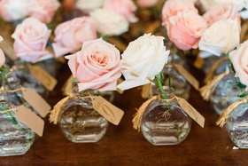Wedding reception favor and table number escort card with fresh roses pink white gold calligraphy