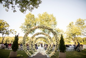wedding ceremony outdoor venue garden circle arches down flower petal aisle minnesota wedding